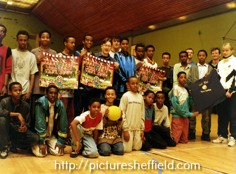 Roger Nilsen (extreme right) of Sheffield United with a group of Somali Youths taking part in a week long coaching scheme organised by the Youth Service Community Recreation and Sheffield United Football Club at Y.M.C.A. Sports Hall