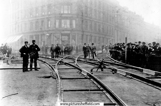 Laying tram tracks at Church Street and Fargate, Cole Brothers Department Store, in background