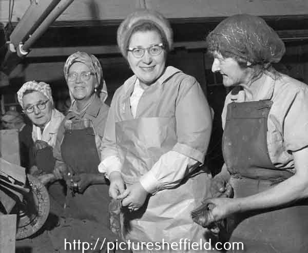 Buffer girls buffing forks at unidentified factory
