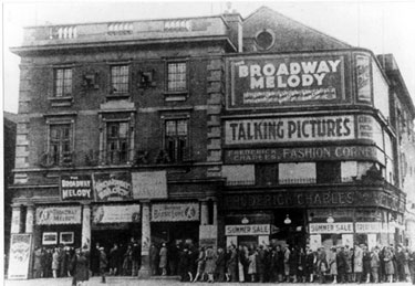 Crowds waiting to see the first musical 'The Broadway Melody' at The Central Picture House, Nos 69/71, The Moor. First opened 30 January 1922. Ended as a cinema after damage in the Blitz of 1940. Demolished May 1961
