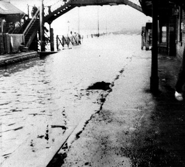 Flooding at Beighton, Beighton Station, the land sinking by nine feet at this point