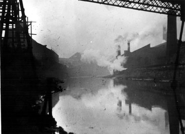View of the River Don, looking west towards Park Iron Works, Foley Street on the left and centre of the photograph with Crescent Steelworks, Warren Street on the right.
