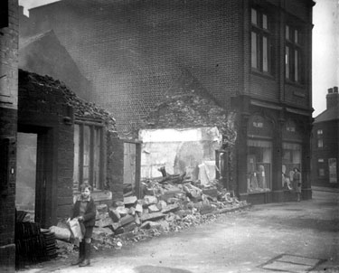 Demolition of Nos. 870-872, Attercliffe Common and Brightside and Carbrook Co-op, Kirkbridge Road with a Black Cat Cigarette Vending Machine extreme left of picture