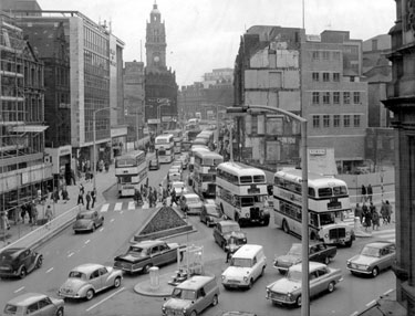 High Street looking towards Fargate, site of Cole Brothers Department Store, right, No 9, Austin Reed Ltd., Men's Outfitters, Fargate Court and Marks and Spencer, left
