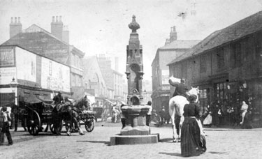 Drinking Fountain at the junction of Shalesmoor/ Gibraltar Street/ Allen Street and Bowling Green Street, looking towards businesses including  Thomas Nixon and son, pawnbroker, Gibraltar Street