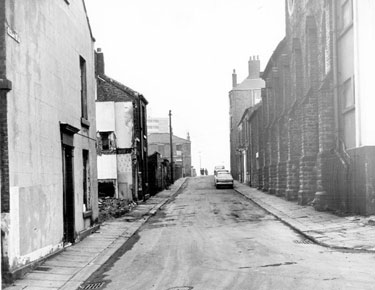Shipton Street looking towards Oxford Street from Addy Street, demolition of Court No 2 and back to back housing, left, former Oxford Picture Palace and Upperthorpe Unitarian Chapel, right, Oxford Villa, in background, left
