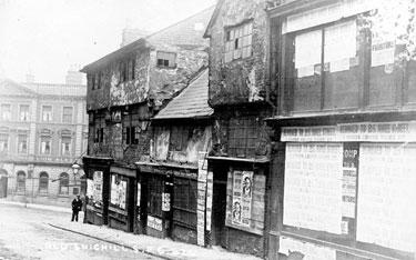 Snig Hill looking towards West Bar, derelict timber framed shops, prior to demolition in 1900. Pack Horse Hotel, West Bar, in background