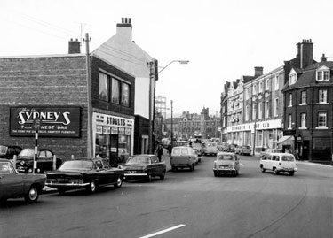 West Bar from Coulston Street looking towards the Police Station showing Nos. 7/9 Sydney's Furnishers Ltd. (left) and Nos. 18, 20, Kaydon Tobacco Ltd. and 22-34, H. Turner and Son Ltd., wholesale newsagent formerly the Blue Boar P.H.