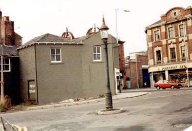 J E Webb Sewer Gas Destructor Lamp at the junction of Broomhall Street and Eldon Street, with West Street. J. Preston Ltd., in background