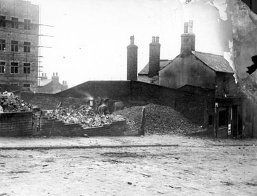 Bard Street, demolition of No. 42, Feathers Inn. Construction of Embassy Court in background