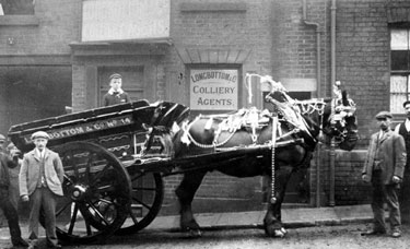 Decorated Horse-Drawn Cart belonging to Thomas W Ward outside Longbottom and Co., Rowland Street