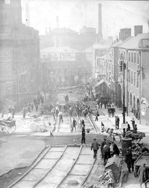 Laying of tram tracks, Waingate looking towards Lady's Bridge, Royal Hotel, right, Court House (old Town Hall), left, Exchange Brewery (Tennant Brothers) in distance