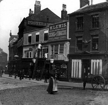 High Street prior to street-widening of 1896, No 4, J. Preston, Chemist, No 6, William Lewis, Tobacconist, No 8, White Bear Inn, Nos 10-14, William Foster and Son Ltd., Tailors