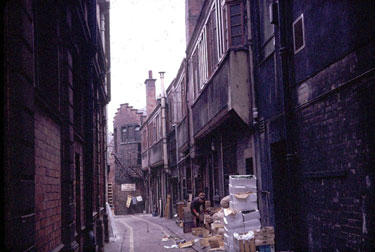Unidentified alley, possibly Black Swan Walk off High Street. Rear of shops fronting Chapel Walk, right