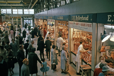 Nos. 45, J.H.Holyhead and 44, L.C. Ward, butchers, Meat and Fish Market, Castle Market looking towards the doorway to Castlegate