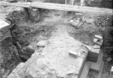 Sheffield Castle excavations recorded by J.B. Himsworth. Ruins of Courtyard buildings (walls and plinth), uncovered on Market Site