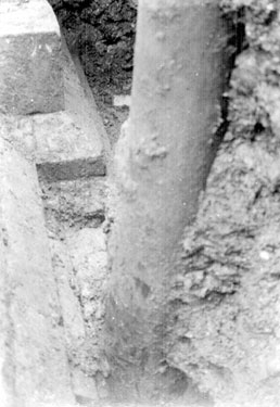 Sheffield Castle excavations recorded by J.B. Himsworth. Ruins of Courtyard buildings (walls and plinth), uncovered on Market Site, nine inches from the base of an old telegraph pole