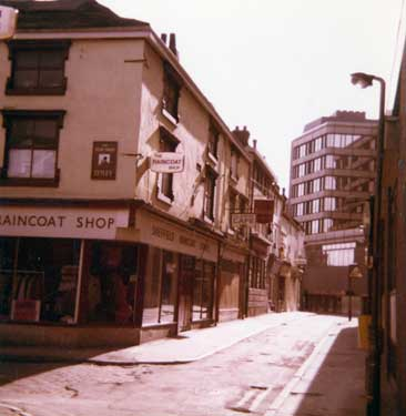 Shops on Orchard Street prior to the Orchard Square redevelopment showing the Sheffield Raincoat Stores (No.21)