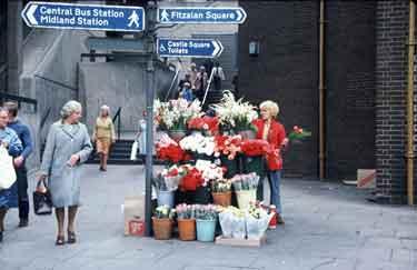 Flower seller at junction of Flat Street and Pond Street
