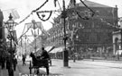 View: s00392 South Street, Moor, decorated for the Royal Visit of King Edward VII, Nos 76-90, John Atkinson, Draper