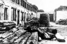 Sheffield Castle excavations recorded by J.B. Himsworth. Remains of Shambles Slaughter House, showing ancient beams discovered in a horizontal position. Newly built sewer manhole (for a new road for the continuation of Bridge Street), in backgrou