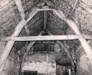 Interior of cruck-built barn with 4 or 5 bays, part of the outbuildings of Norton House, Norton Lane